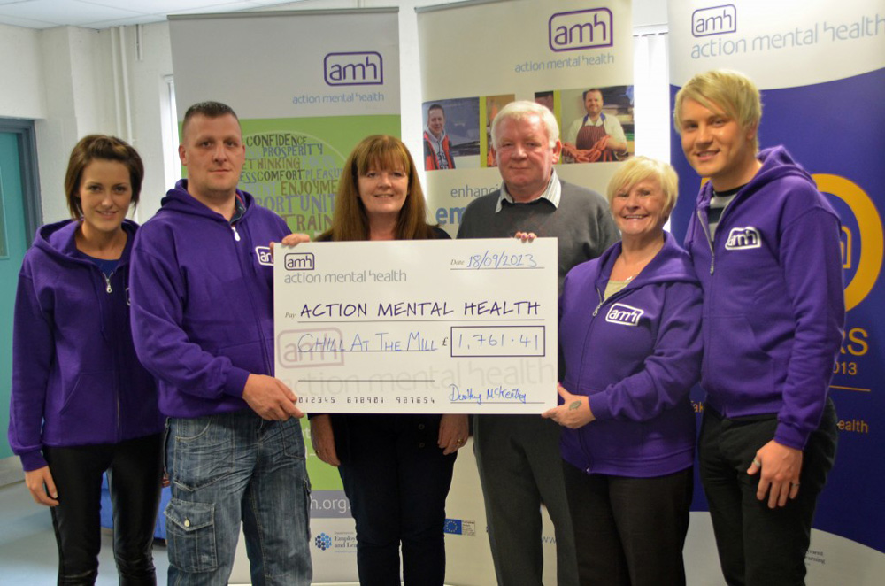 The McKeating family present their donation to clients and staff of AMH