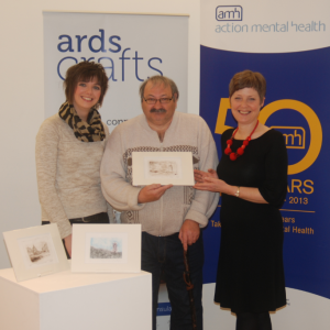 Clients and staff of AMH's New Horizons Service in Newtownards hand over 36 original prints they created to Heather Parker, Craft Development Manager with Ards Borough Council. Ards Crafts will sell the prints at £25 each in the run up to Christmas.