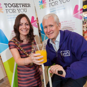 Lord Mayor of Belfast, Nichola Mallon encourages David Babington, Chief Executive of Action Mental Health on the pedal powered smoothie bike!
