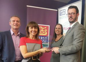 First Trust, Denise Black, HR Business Partner (receiving award) Gary McMurray and Sinead McArt