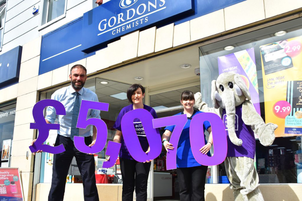 Staff at Gordon's Chemists reveal their amazing fundraising boost to AMH